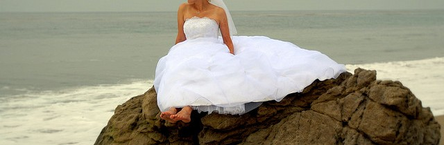 bride posing in the beach