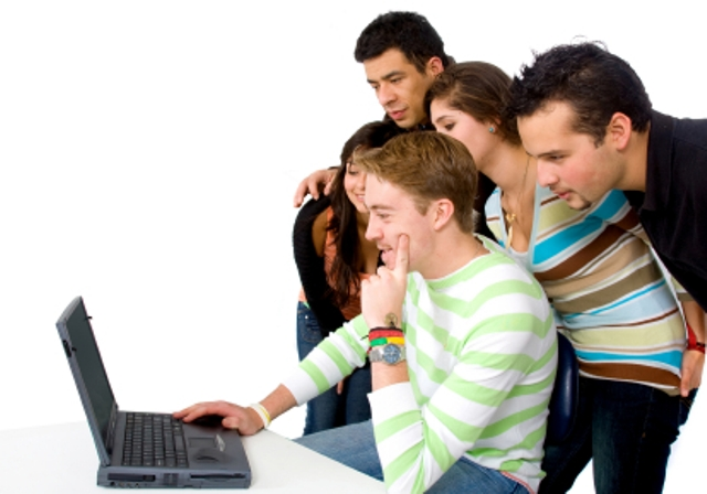 group of people on a laptop over a white background