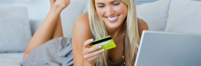 Sexy woman shopping online with credit card