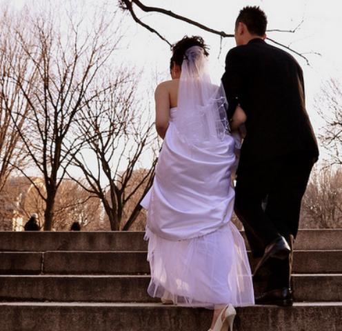 Newlyweds Walking Up Stairs