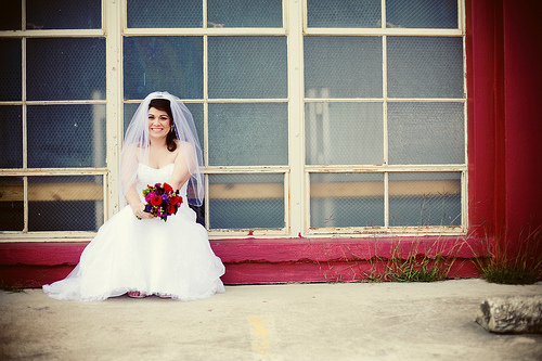 bride sitting on the window