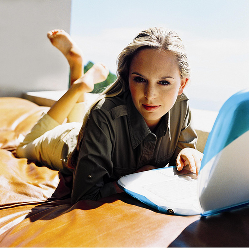 lady on the bed using laptop