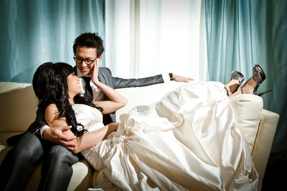 bride and groom at the couch