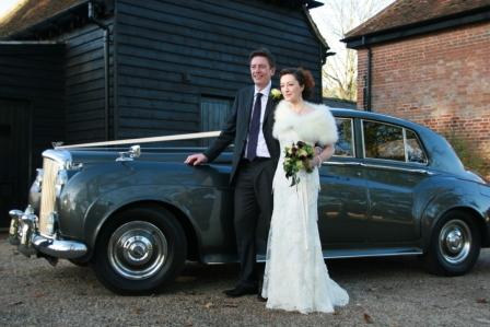 bride and groom outside the car