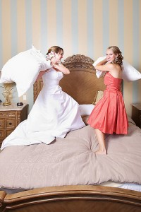 two ladies playing with pillows