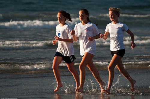 Ladies running on the beach