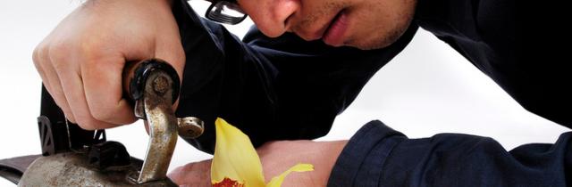 man pressing flower